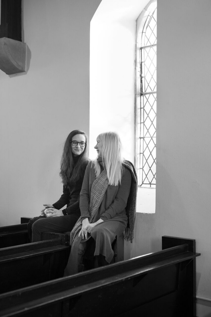 Keeping our bums warm on the heater in a freezing church whillst filming our videos!
